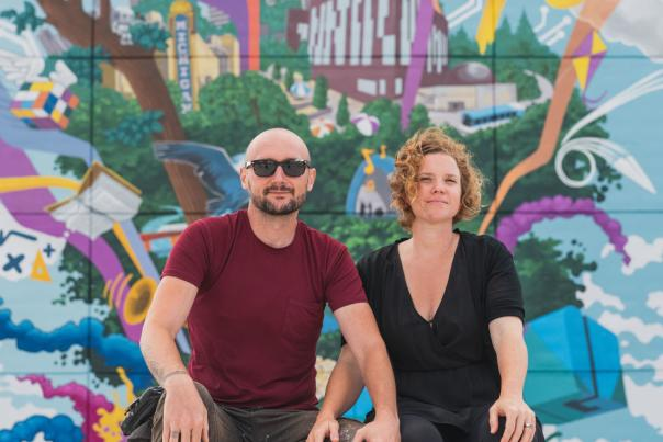 Danijel Matanic and Mary Thiefels in front of Mural