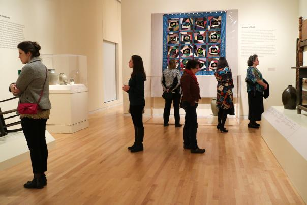 People viewing a quilt at the Georgia Museum of Art