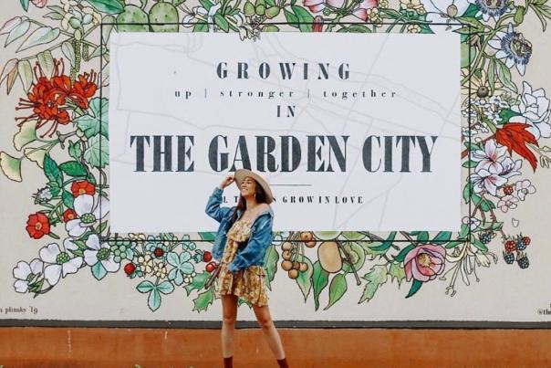 Women Posing In Front of Garden City Mural in Augusta