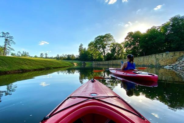 Friends Kayaking Down a Lake In Augusta
