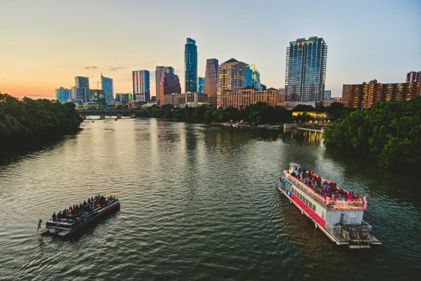 River Boats Sunset Skyline. Courtesty Austin Convention & Visitors Bureau, Credit Geoff Duncan. Expires May 31, 2020.