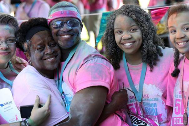 Woman with metals attending the Gift of Life Color Rush