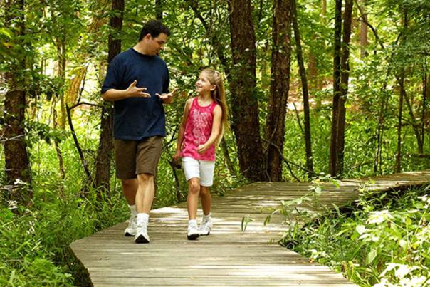 Father and Daughter on Trail Hike in Southeast Texas