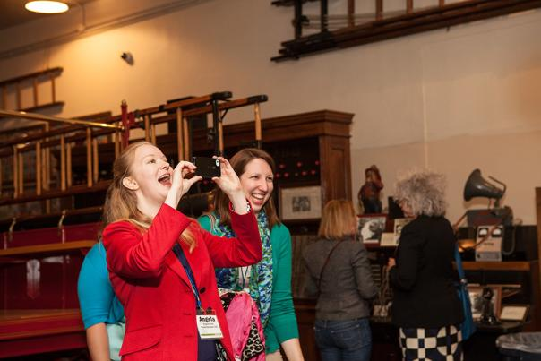Convention attendee takes photo at Fire Museum conference event