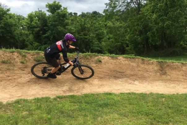 Mountain biker riding a trail in Bentonville Arkansas