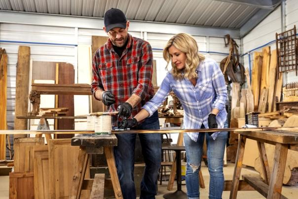 Jenny and Dave Marrs, start of HGTV's Fixer to Fabulous,  in a wood-working shop