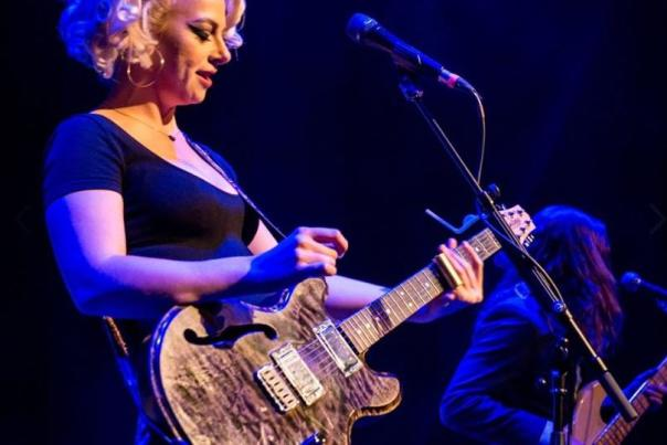 Image of Samantha Fish on stage playing her guitar