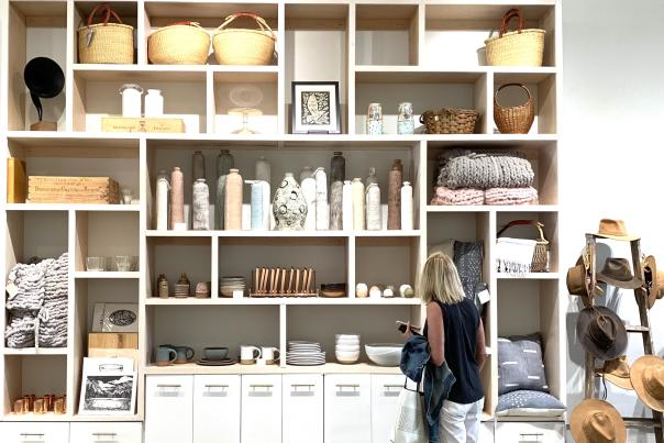 A woman browses in front of shelves at Common Good Co.