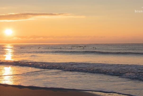 Sunrise over the ocean in Oak Island, NC.
