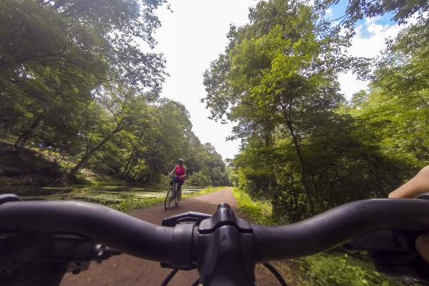 Biking the Delaware Canal woman passing Go Pro AS
