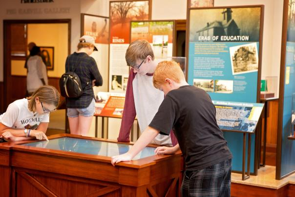 children enjoy a museum exhibit