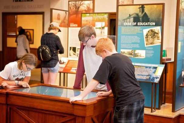 children enjoy a museum exhibit