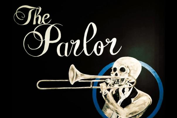 The Parlor music venue logo of skeleton playing trombone