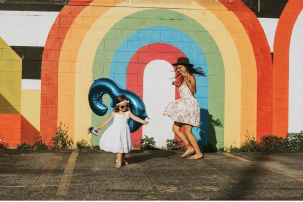 Girls frolic in front of Cbus Color Wall mural