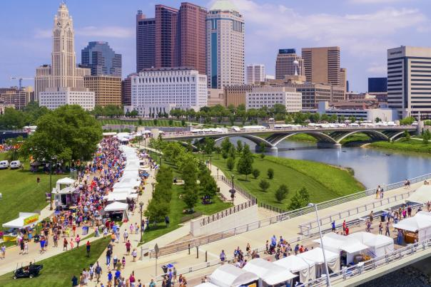 Crowd and booths along the riverfront at the Columbus Arts Festival