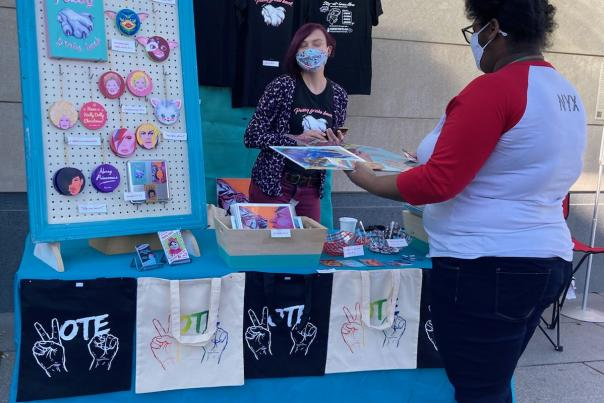 Masked shoppers at the Craftin Outlaws holiday pop-up market