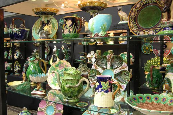 Various antique china teapots, dishes, plates and other home decor