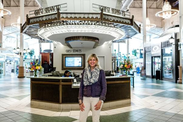 Easton Chief Executive in front of Guest Services