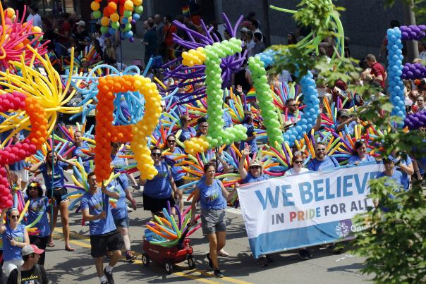 """Rainbow balloons spelling out the word """"PRIDE"""" during Columbus Pride parade"""