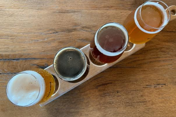 View from above of flight of four unique craft beers at BrewDog