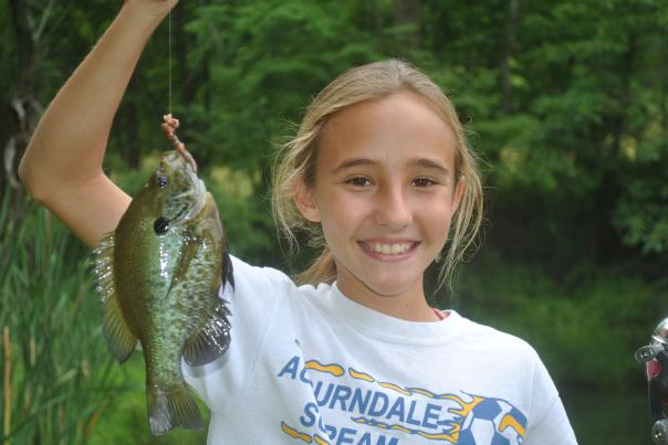 Little girl with fish