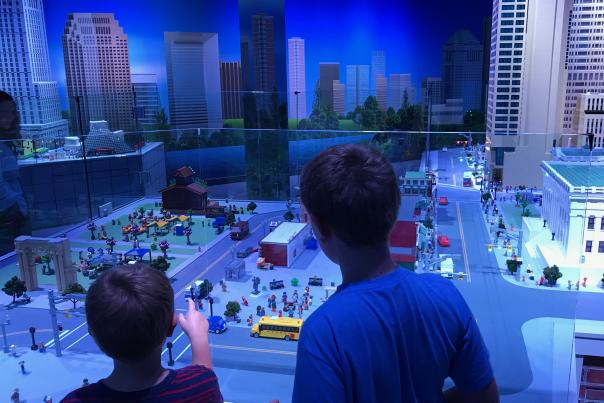 Two boys admiring re-creation of Columbus made completely of Lego bricks at LEGOLAND Discovery Center