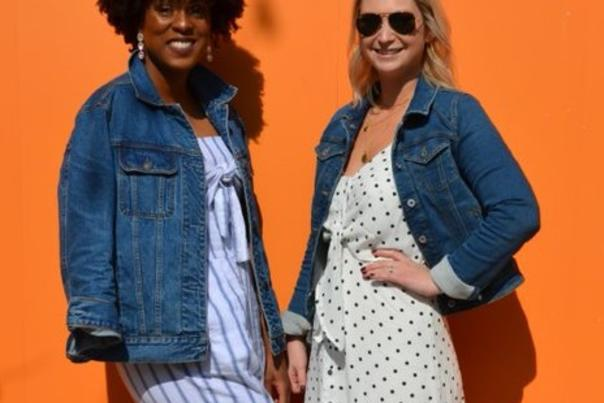 Two women in stylish summer clothing and denim jackets with sandals