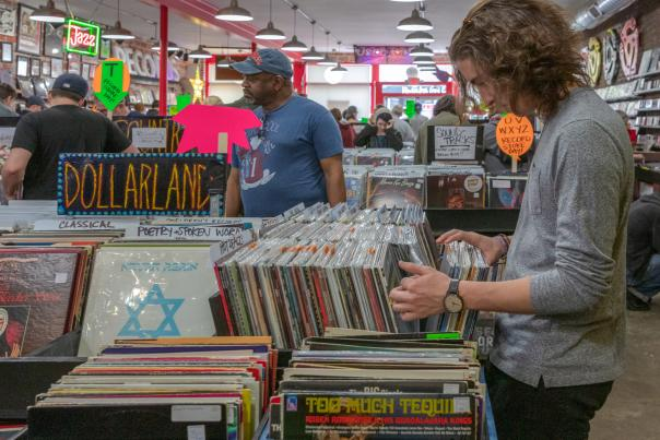 Young man digging in record crates at Used Kids Records