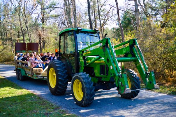 John Deere tractor pulling a trailer of people at the Fall Furnace Festival