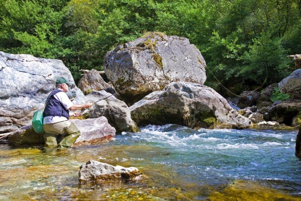 Fisherman_angling_trout_on_the_river_BLOG