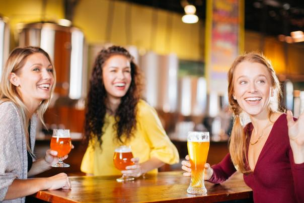 Girls drinking craft beer from Ever Grain Brewing