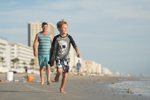 A family enjoys beach time together in Daytona Beach