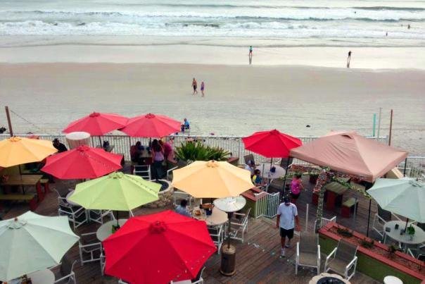 Colorful umbrellas dot the deck at a Daytona Beach oceanfront restaurant