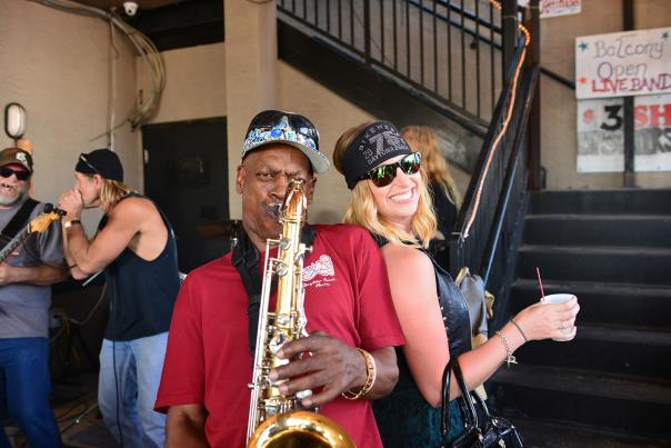 Saxophonist plays a solo during during Bike Week.