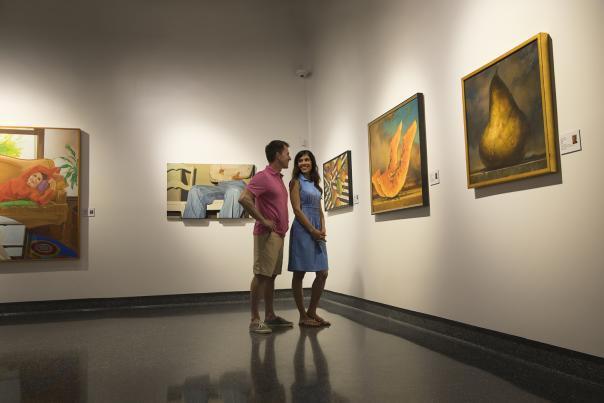 A couple views an art exhibit at a Daytona Beach museum.