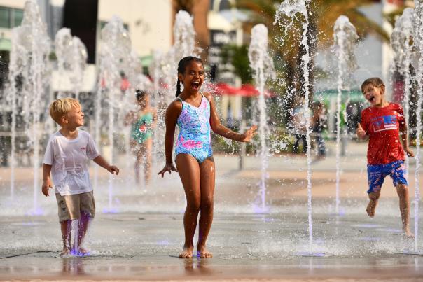 Children jump and play at ONE DAYTONA'S splash pad