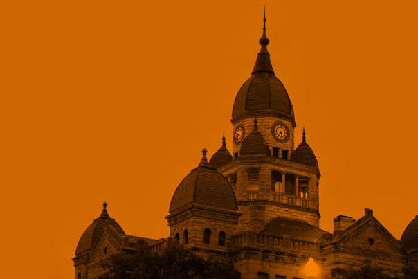 The top half of the Courthouse-on-the-Square with an orange filter