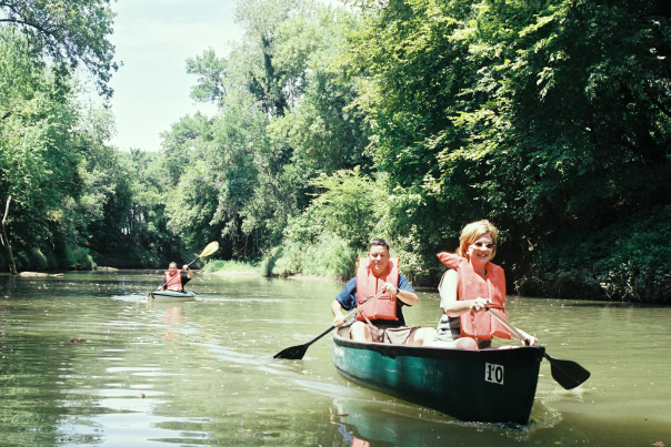 A couple canoeing on the Elm Fork Trinity River at the Greenbelt Trail