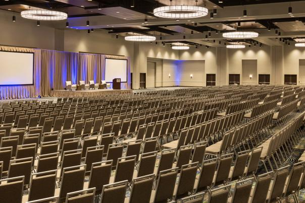 large conference room full of empty chairs and projection screens