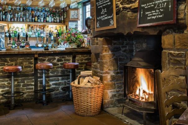 Bar with log fire at The Acorn Inn, Dorset