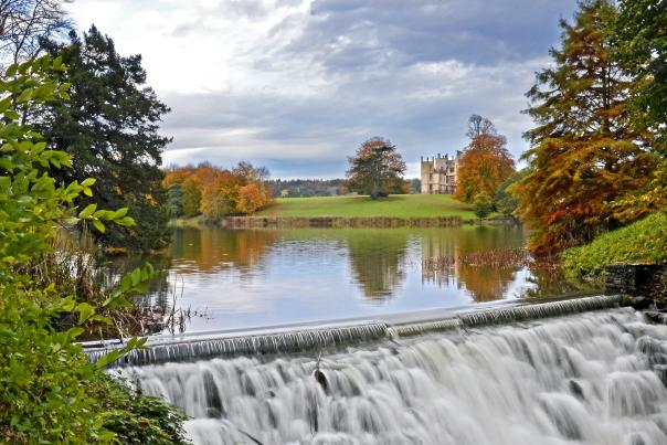 Sherborne Castle lake and water cascade in autumn