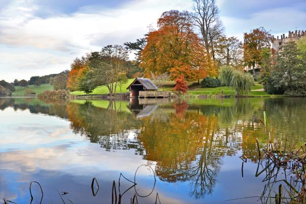 Sherborne Castle lake and boathouse in autumn
