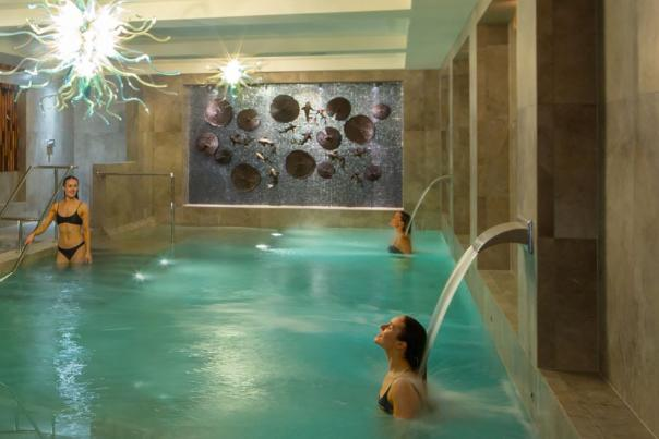 Two people in the Hydrotherapy Pool at Monart Spa Poundbury