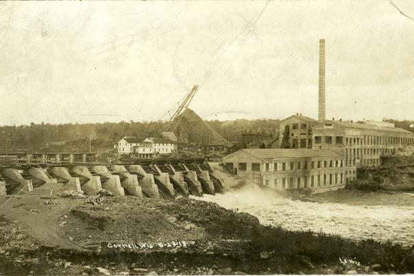 Cornell Dam with pulpwood stacker and mill, 1913