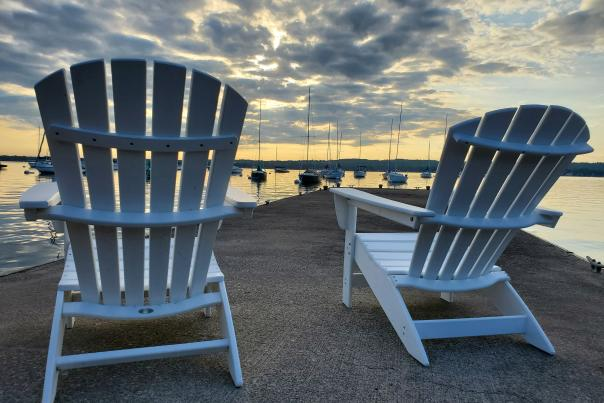 Two chairs overlooking Canandaigua Lake at Sunrise