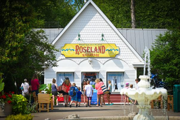 The entrance of Roseland Waterpark with people out front buying tickets