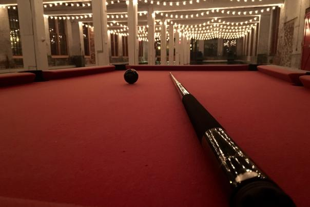 Pool table with cue stick at Cracker Factory