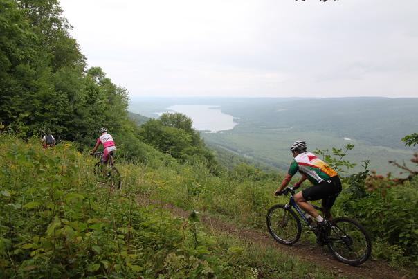finger-lakes-harriet-hollister-state-park-fall-scenic-view-mountain-bikers-trail-group-green-pink