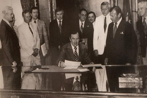 The late Gov. Hugh Carey signs the New York Farm Winery Act of 1976 in Albany.