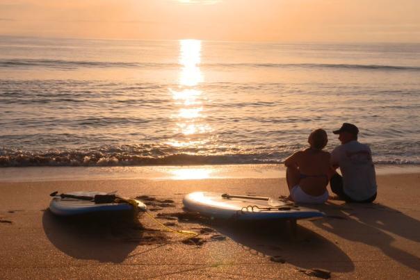 couple romance beach sunrise
